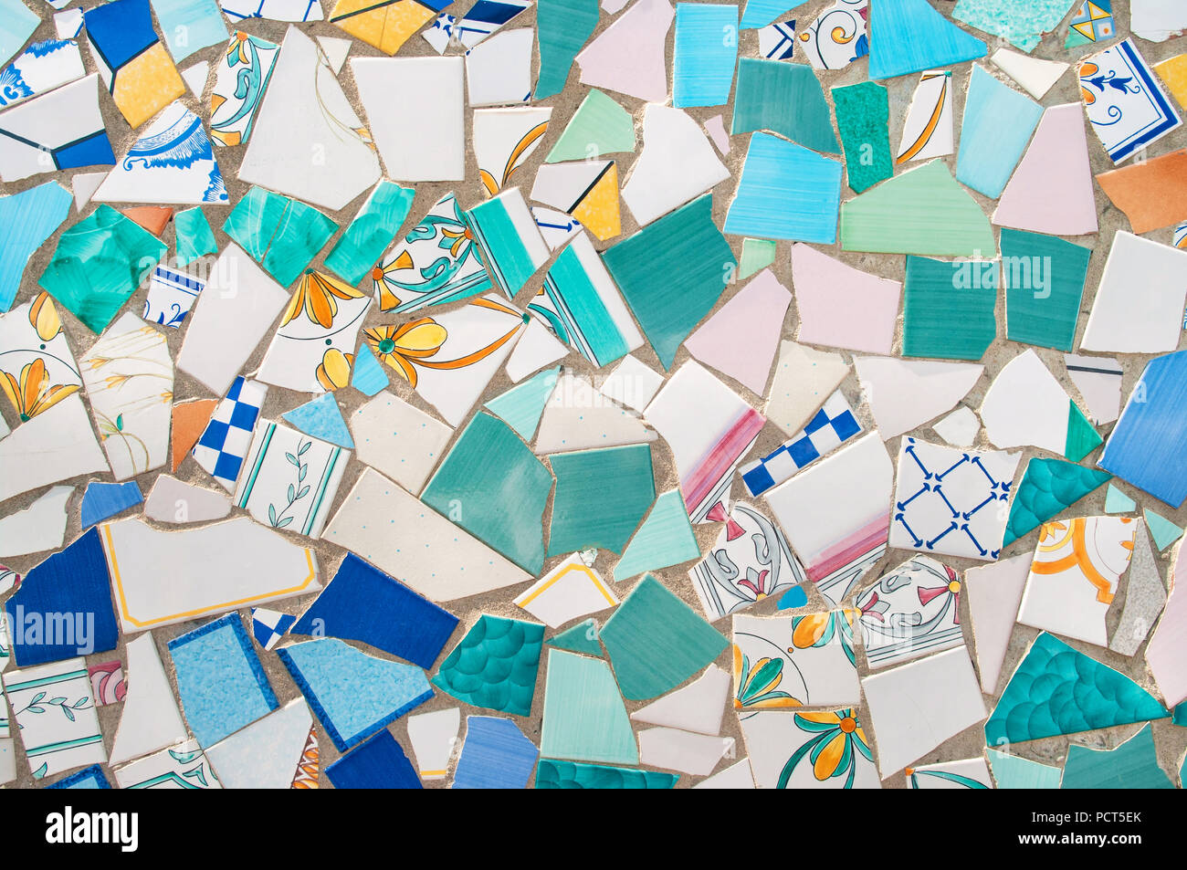 broken pieces of beautiful ceramics tiled in mosaic on street wall in ceramic capital of Italy, Vietri Sul Mare, Campania, Italy Stock Photo