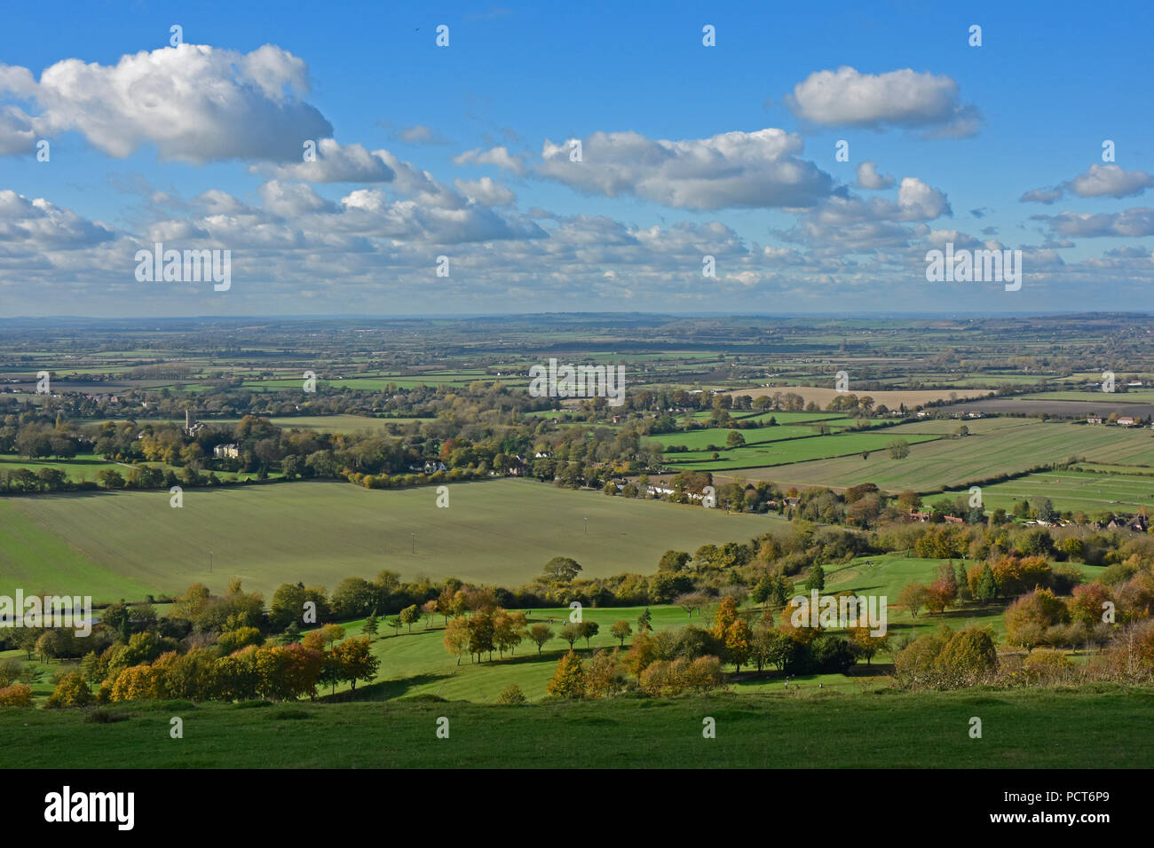 Bucks - Chiltern Hills - view from Coombe Hill over the Aylesbury Plain - sunlight - early autumn colours - cloud flecked blue sky - Stock Image
