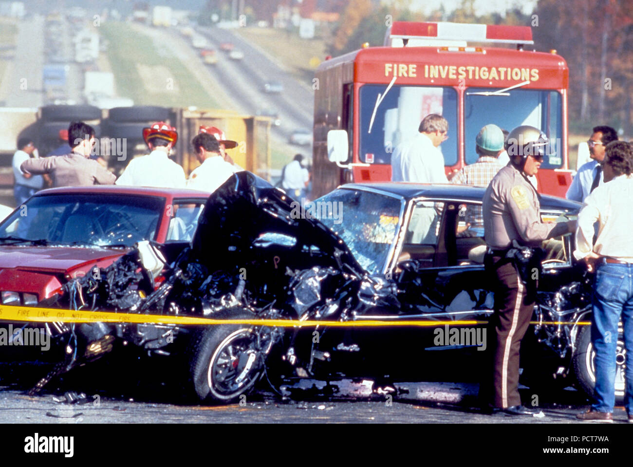 This photograph, captured in metropolitan Atlanta, Georgia, depicts what had been a severe motor vehicle collision. At this point, Atlanta police, paramedics, and the Fire Investigation Team, were all on the scene. The drivers' conditions were not known, nor the details surrounding the cause of this accident. - Stock Image