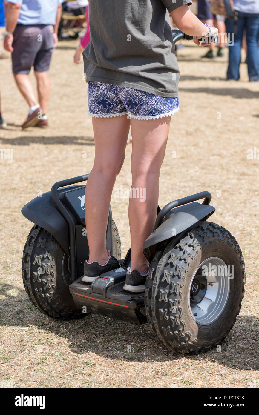 professional all terrain Segway personal transportation vehicle with young girl driving on two wheeled vehicle. - Stock Image