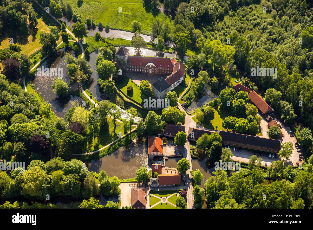https www alamy com view of the rheda castle moated castle with trees rheda wiedenbrck east westphalia north rhine westphalia germany image214434820 html