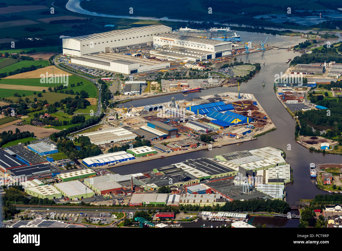 Aerial photo, shipyard, Papenburg Port on the Ems River with Jos L Meyerwerft Shipyard and Quantum of the Seas cruise liner, Royal Caribbean Papenburg, Emsland, Lower Saxony, Germany - Stock Image