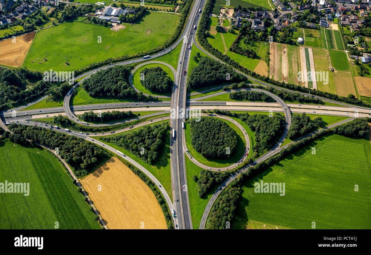 Aerial photo, Autobahnkreuz Mönchengladbach interchange, A61 and A52 Autobahnen (motorways), cloverleaf interchange, road traffic, Mönchengladbach, Lower Rhine, North Rhine-Westphalia, Germany - Stock Image