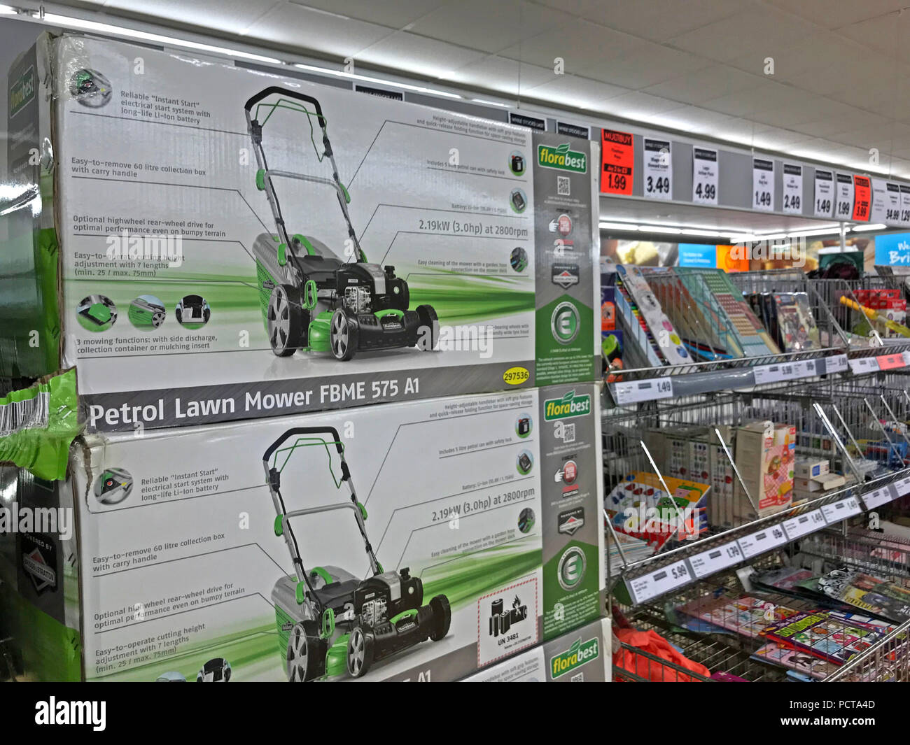 Centre Aisle of a discount supermarket, Lidl, Aldi, lawnmowers, hedge trimmers, Latchford, Warrington, Cheshire, North West England, UK - Stock Image
