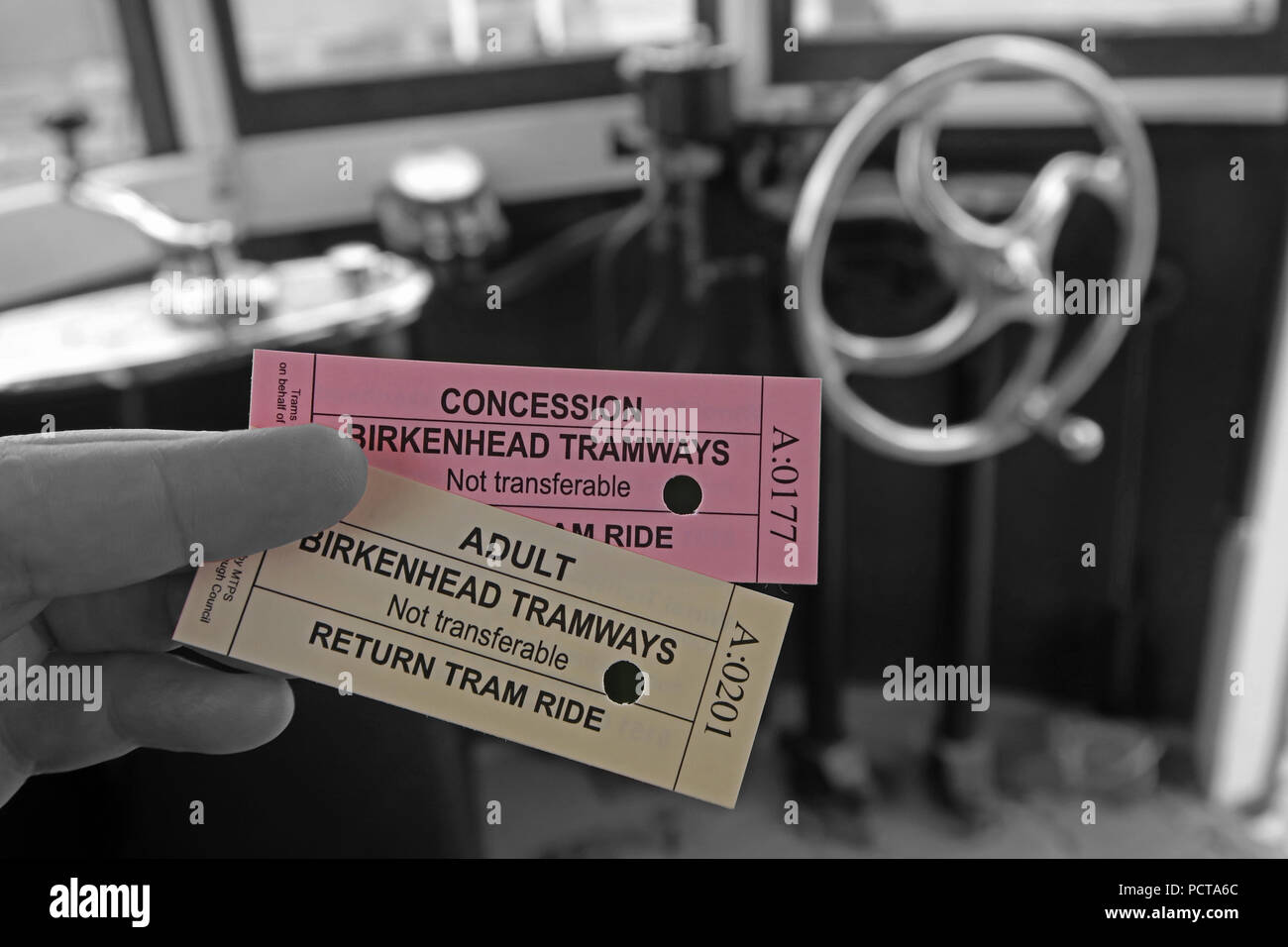 Tram tickets, being punched, Birkenhead Tramways, Merseyside, North West England, UK - Selective Colour - Stock Image