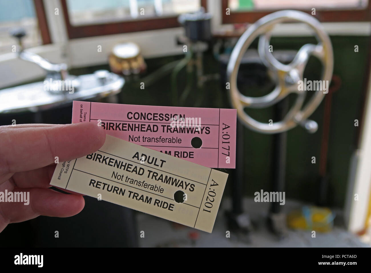 Tram tickets, being punched, Birkenhead Tramways, Merseyside, North West England, UK - Stock Image