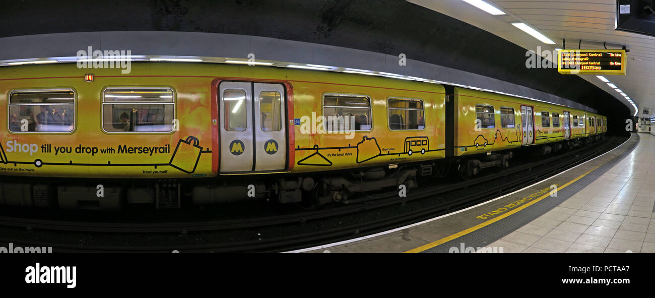 Yellow Merseyrail, Liverpool EMU underground train, at Birkenhead Hamilton Square Railway Station, Merseyside, North West England, UK - Stock Image