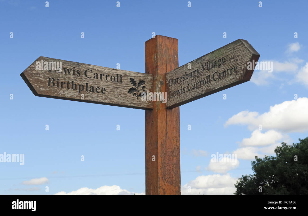 Fingerpost to Lewis Carroll Birthplace & Lewis Carroll Centre, Morphany Lane, Daresbury, South Warrington, Cheshire, North West England, UK - Stock Image