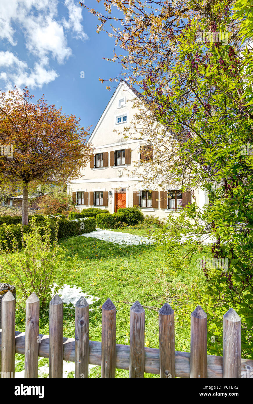 House facade and front yard in Oberammergau, spring, Bavaria, Upper Bavaria, Germany - Stock Image