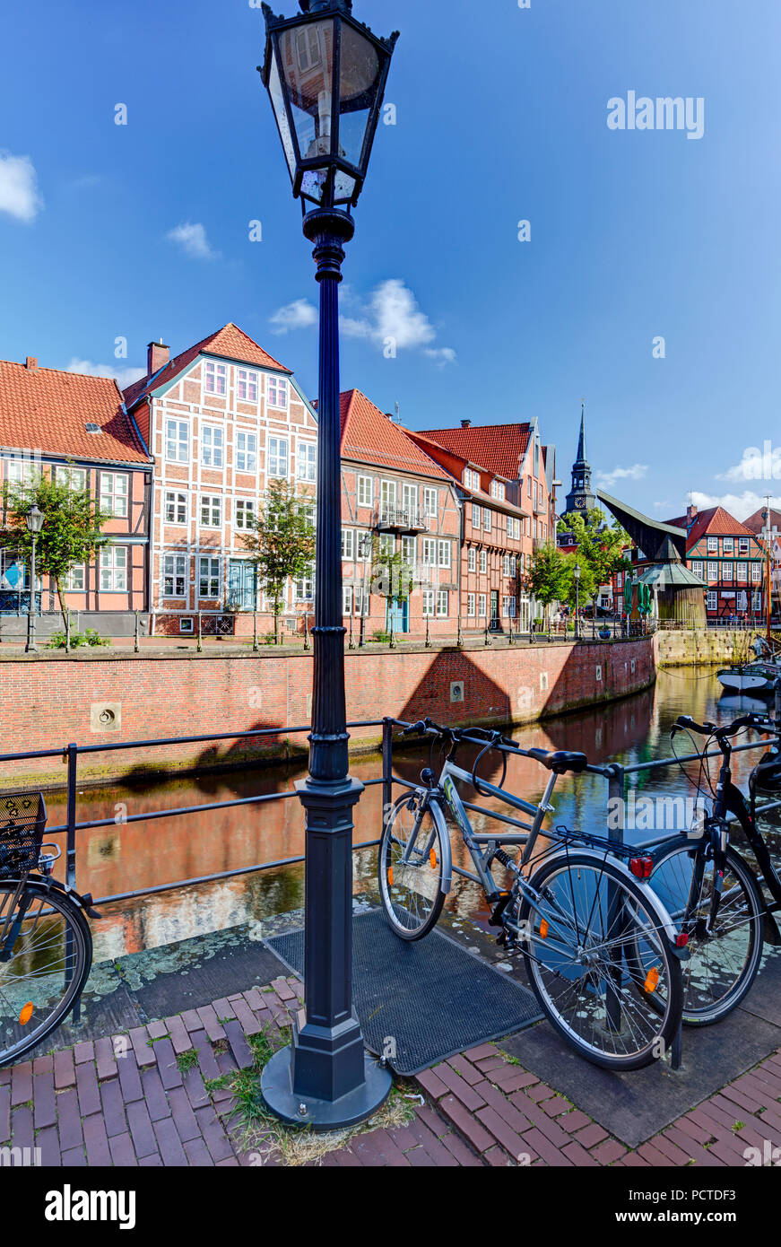 Bicycles at Hanse harbour, half-timbered houses, Stade, Altes Land, Niederelbe, Lower Saxony, Northern Germany, Germany, Europe - Stock Image