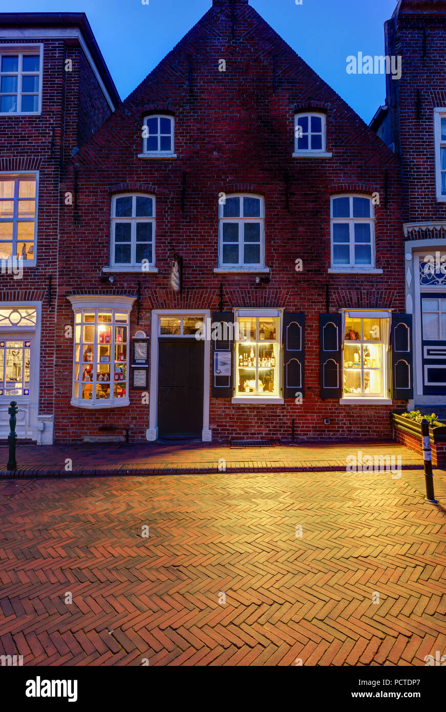 Blue hour, Greetsiel, center, Facade, East Frisia, Lower Saxony, Germany, - Stock Image