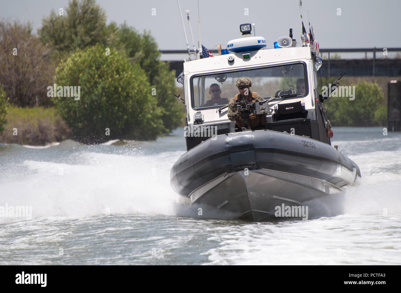 Members of Port Security Unit 309 waterside division underway for a Anti-terrorism, Force Protection Mission Patrol, Guantanamo Bay, Cuba, July 23, 2018. Port Security Unit 309 is deployed for 9 months in support of Operation Freedom's Sentinel. Stock Photo