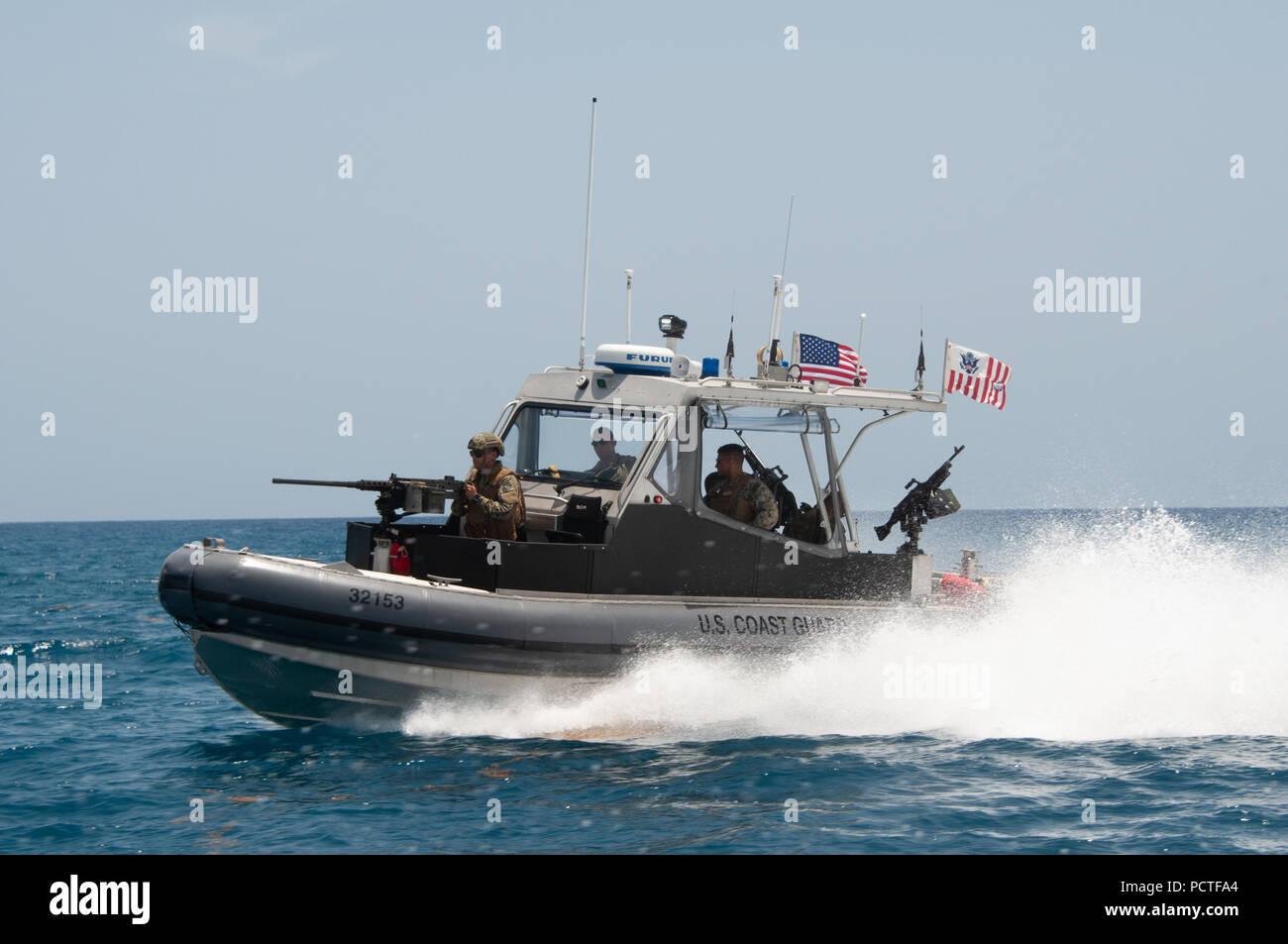 Members of Port Security Unit 309 waterside division underway for a Anti-terrorism, Force Protection Mission Patrol off the coast of Guantanamo Bay, Cuba, July 23, 2018. Port Security Unit 309 is deployed for 9 months in support of Operation Freedom's Sentinel. - Stock Image