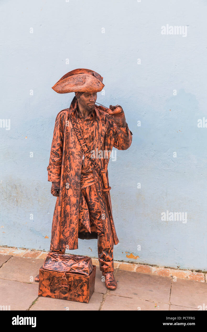 Pirate-dressed street artist, Trinidad, Sancti Spiritus Province, Cuba, Cuba, Greater Antilles, Caribbean Stock Photo