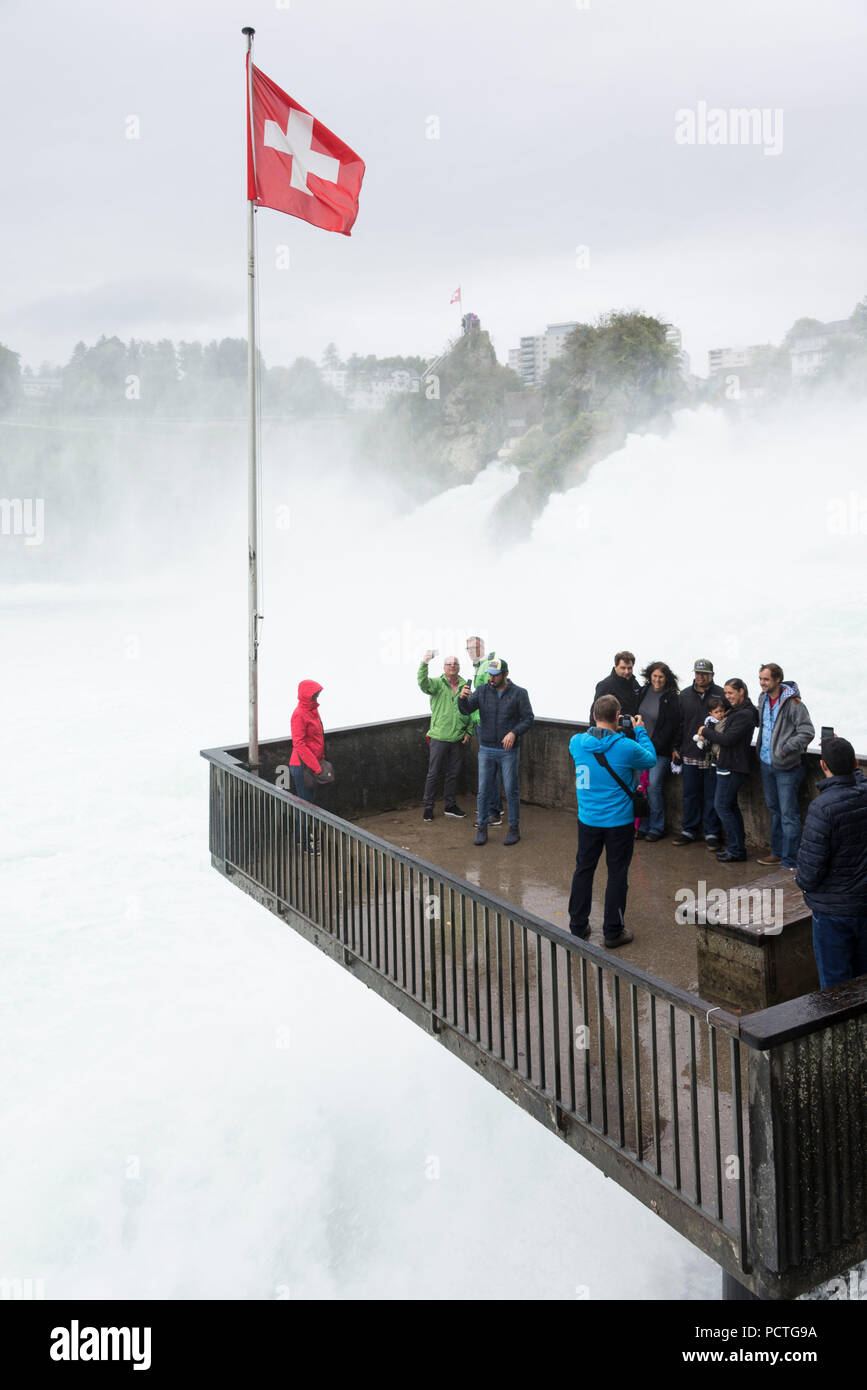 View from observation terrace on Rhine Falls and Rhine Falls rock with view of Neuhausen, canton Schaffhausen, Switzerland Stock Photo