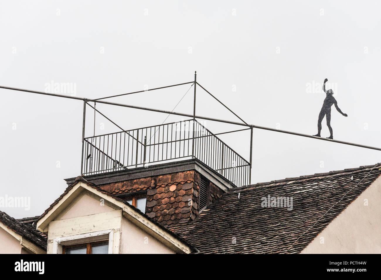Tightrope walker above the city, Spalenberg, Basel, Canton Basel, Switzerland - Stock Image
