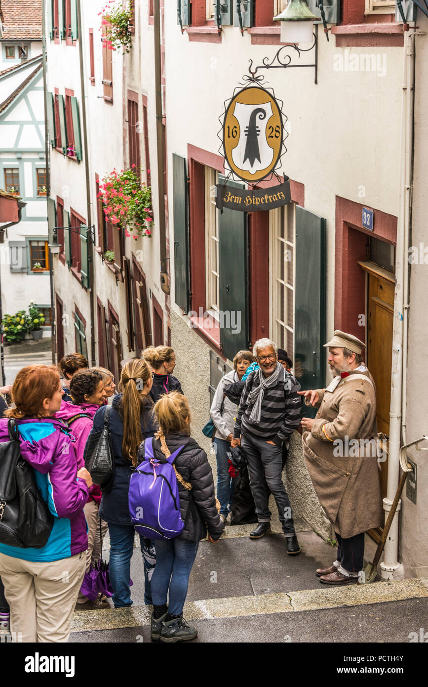 City tour with Grabmacherjoggi in the alley Spalenberg, old town Grossbasel, Basel, Canton Basel-City, Switzerland - Stock Image