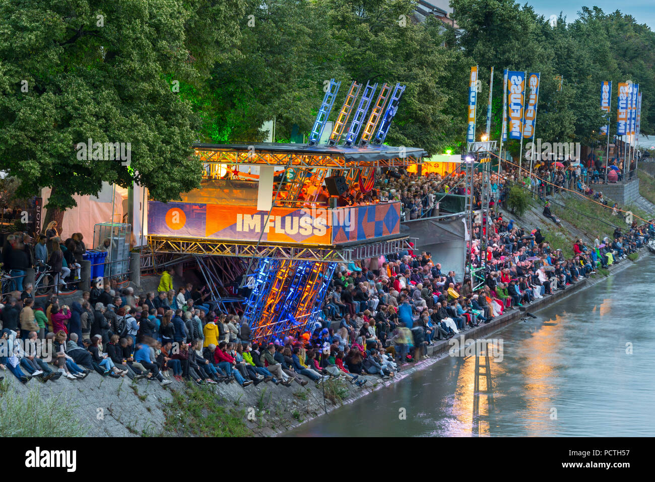 Crowd at the riverbank at the 'Imfluss' Open Air Festival on the banks of River Rhine, Kleinbasel, Basel-Stadt, Canton of Basel-Stadt, Switzerland - Stock Image