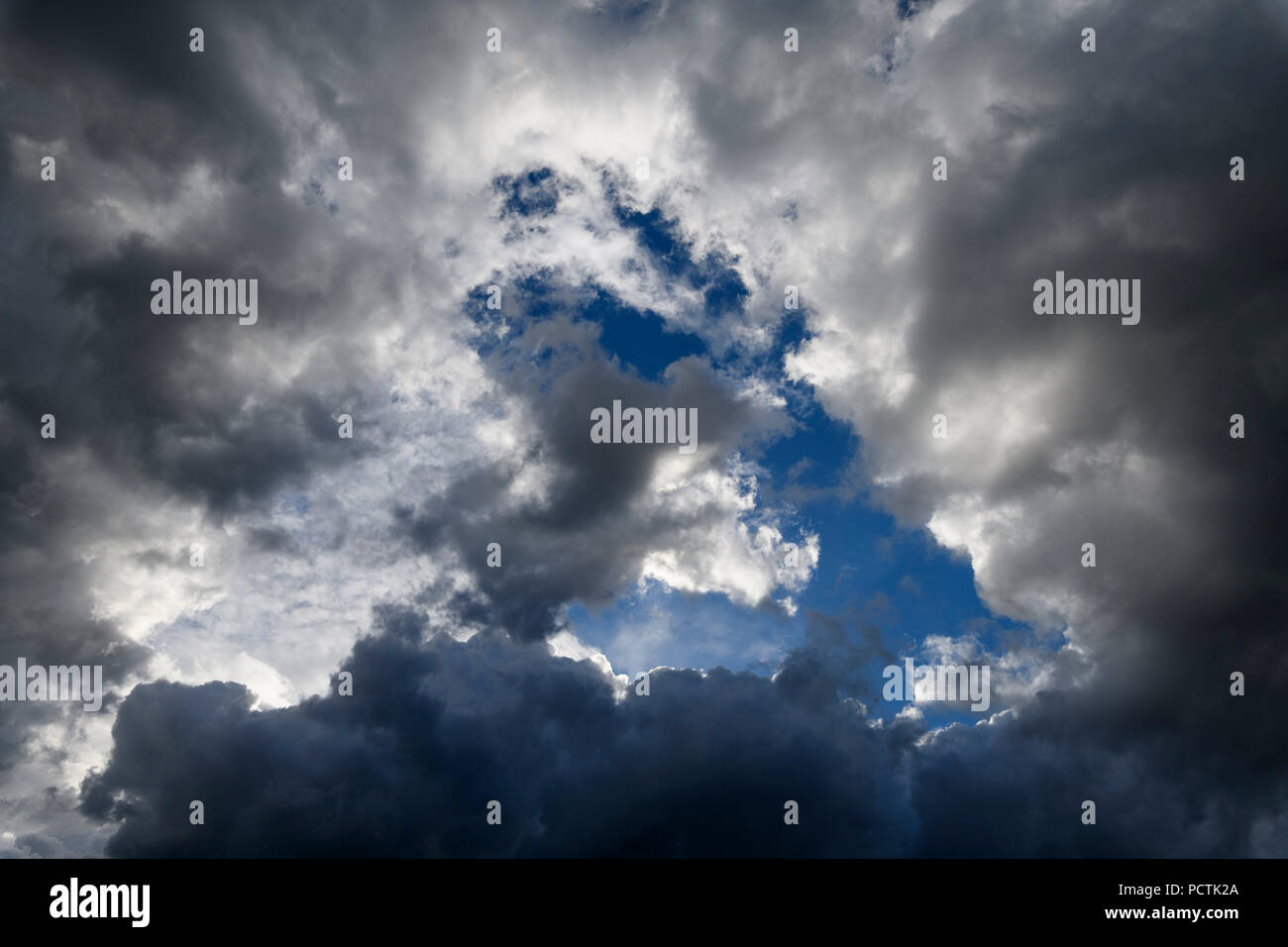 Cloud hole in cloud cover, Germany - Stock Image