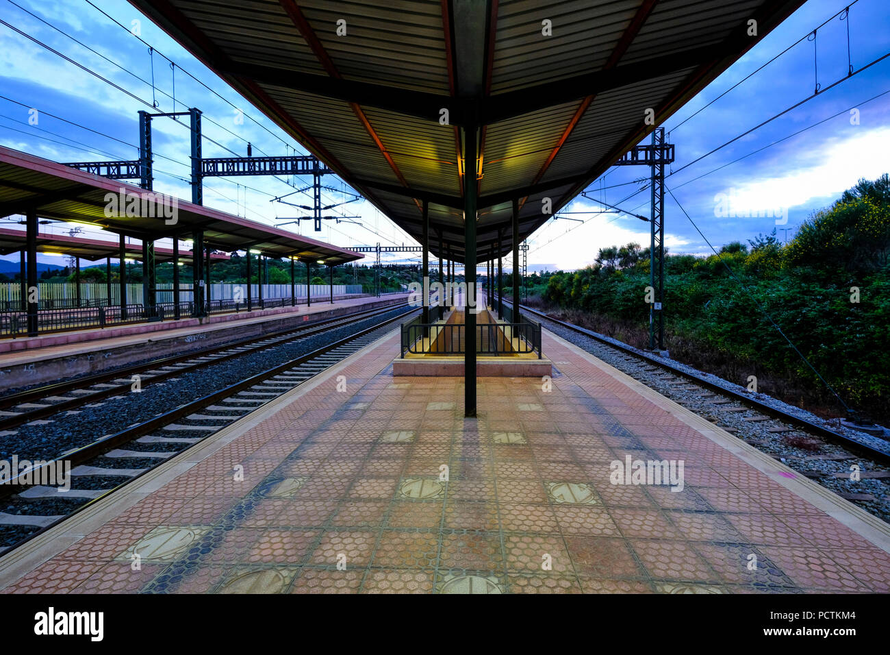 Train station without people at sunset in the metropolitan area of Barcelona in Catalonia Spain - Stock Image