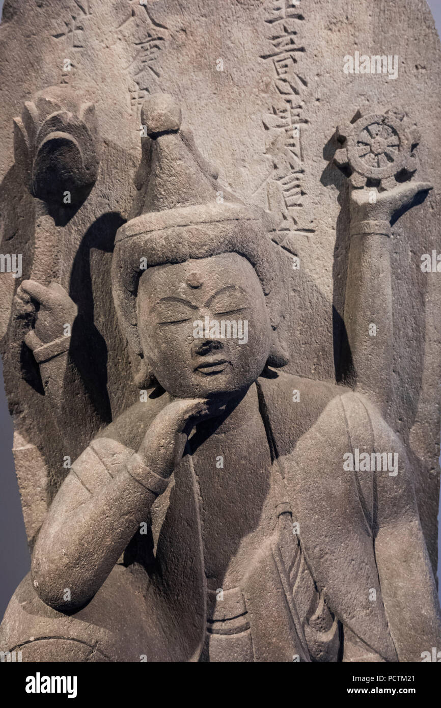 Stone Sculpture of Nyoirin Kannon dated 1680 - Stock Image