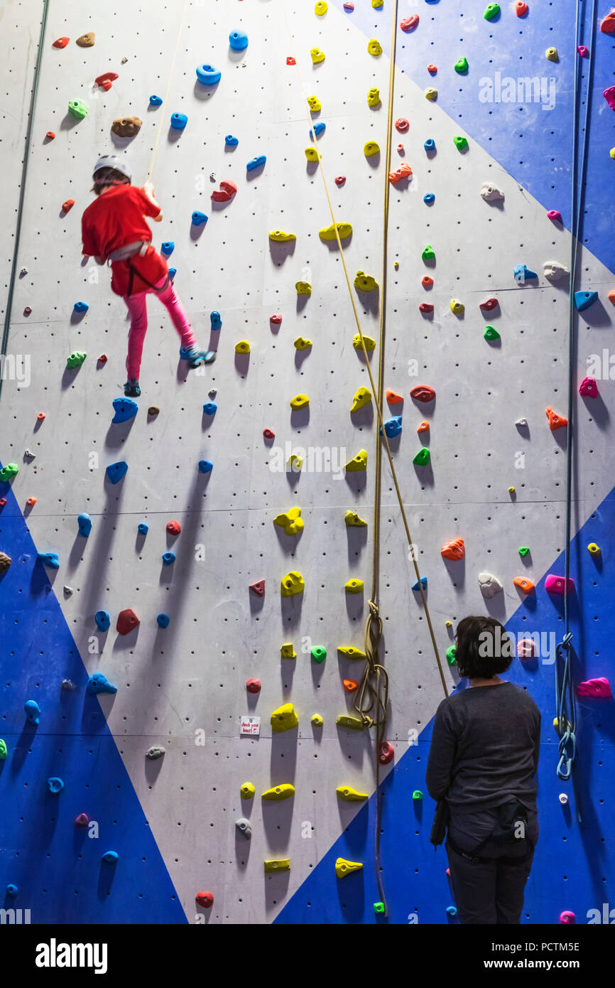Great Britain, Scotland, Scottish Highlands, Kinlochleven, The Ice Factor Attraction, Child Practicing Rock Climbing - Stock Image