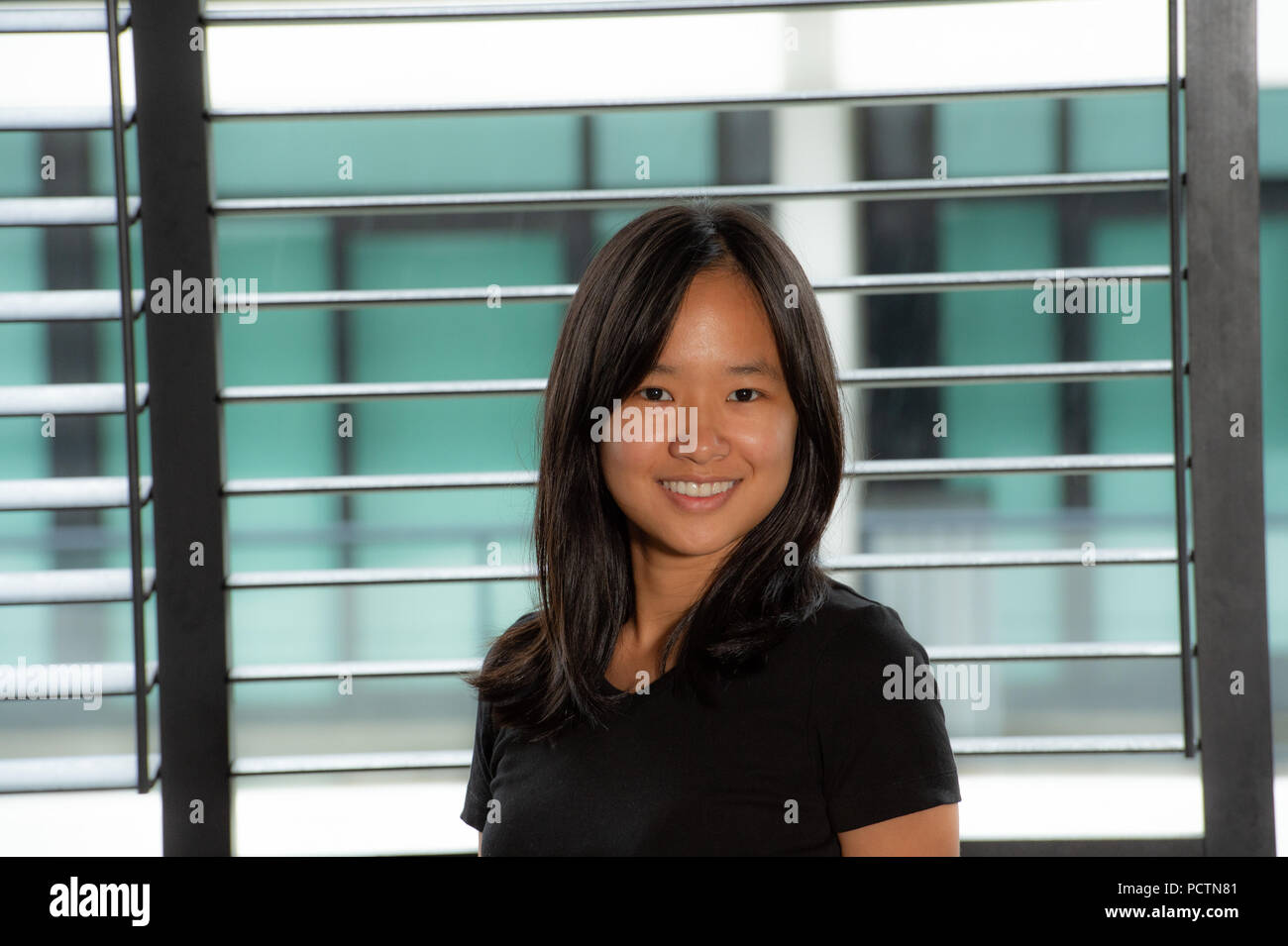 2c576d3a04 Beauty portrait of asian woman in a black shirt and white jean shorts -  Stock Image
