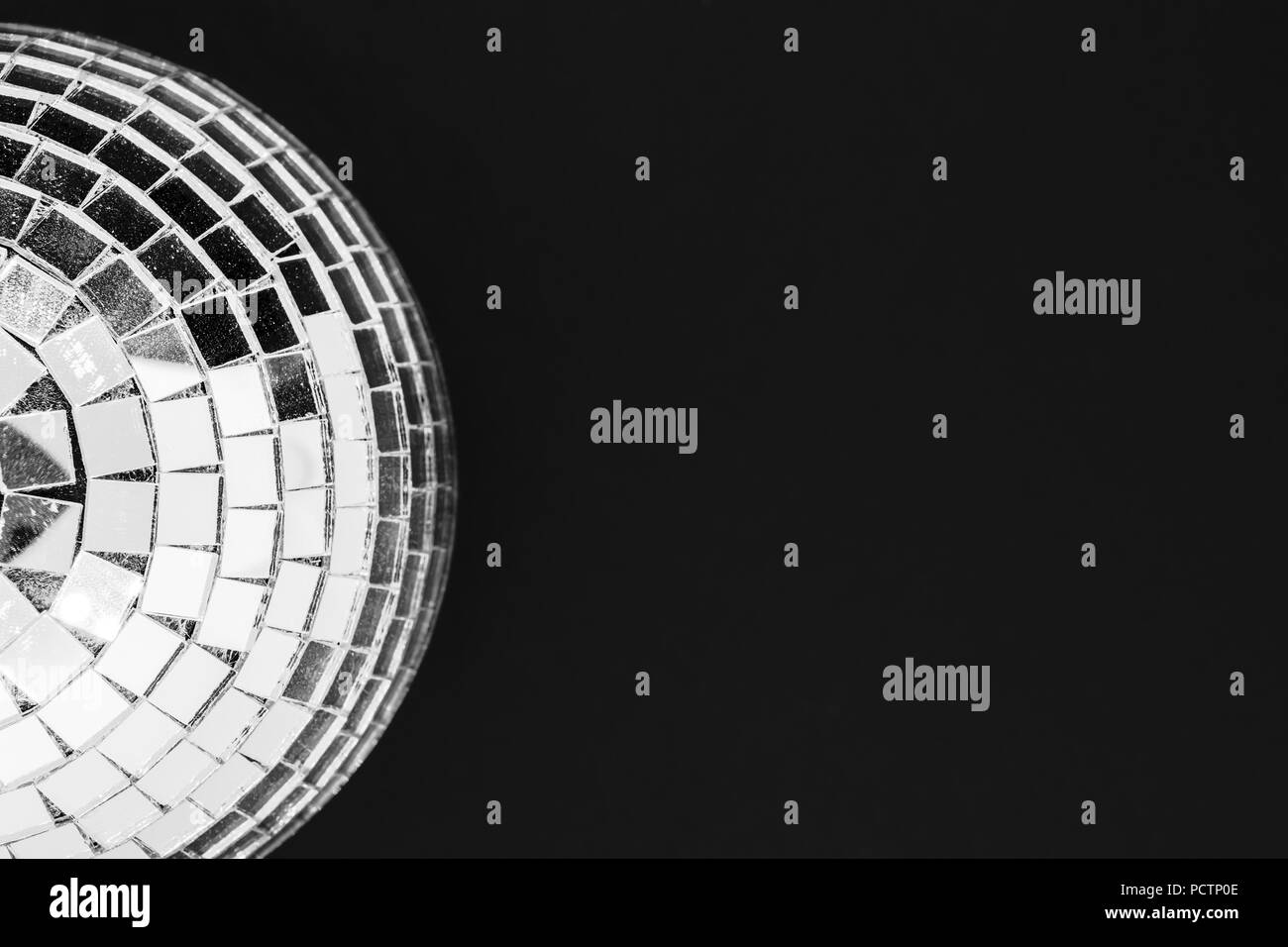 Dusty disco ball made from glass isolated on black background surface Stock Photo