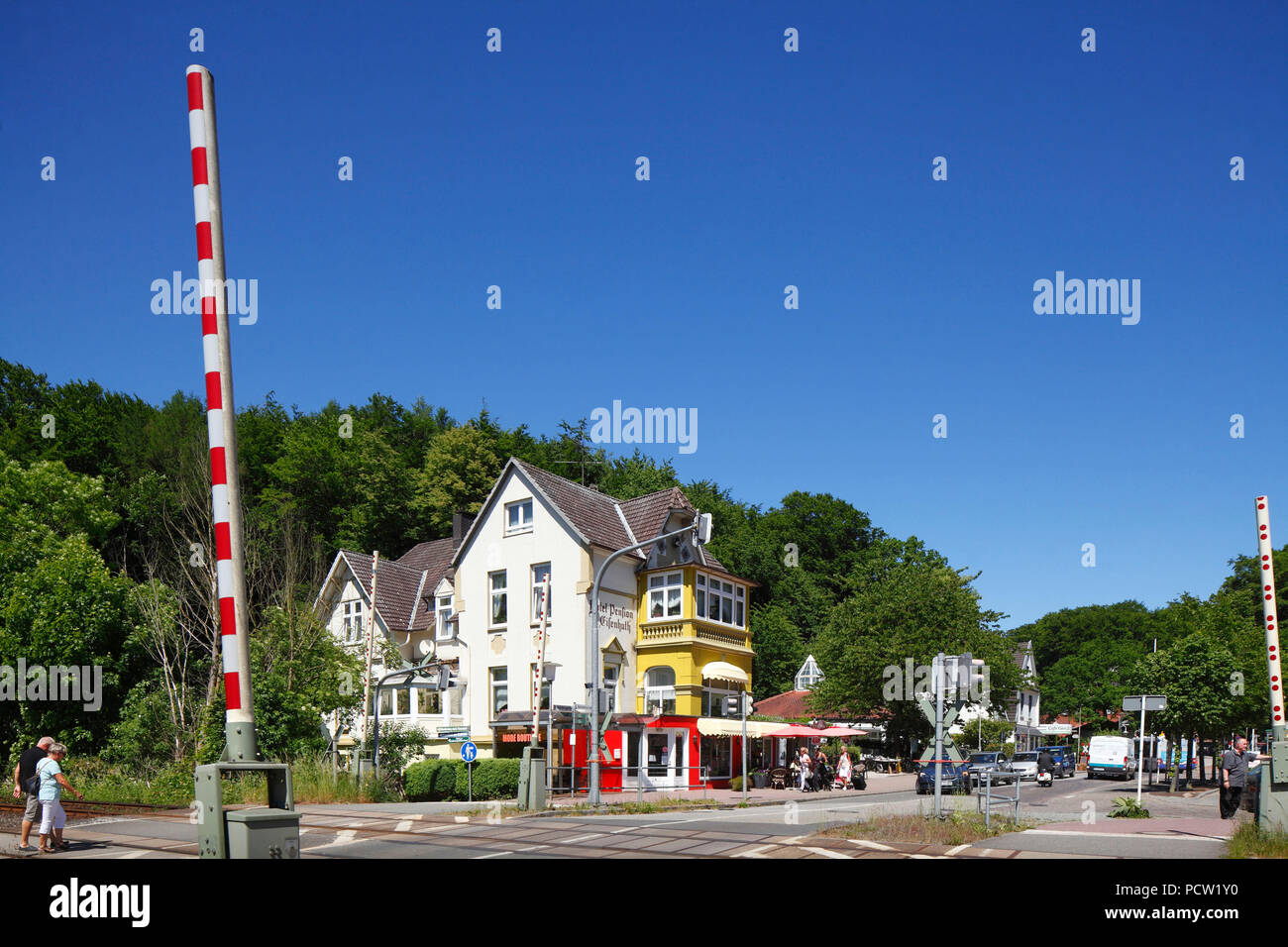 Limited railroad crossing with open gate, Hotel-Pension Elisenhuth in the Hindenburgallee, Bad Malente-Gremsmühlen, Malente, Schleswig-Holstein, Germany, Europe - Stock Image