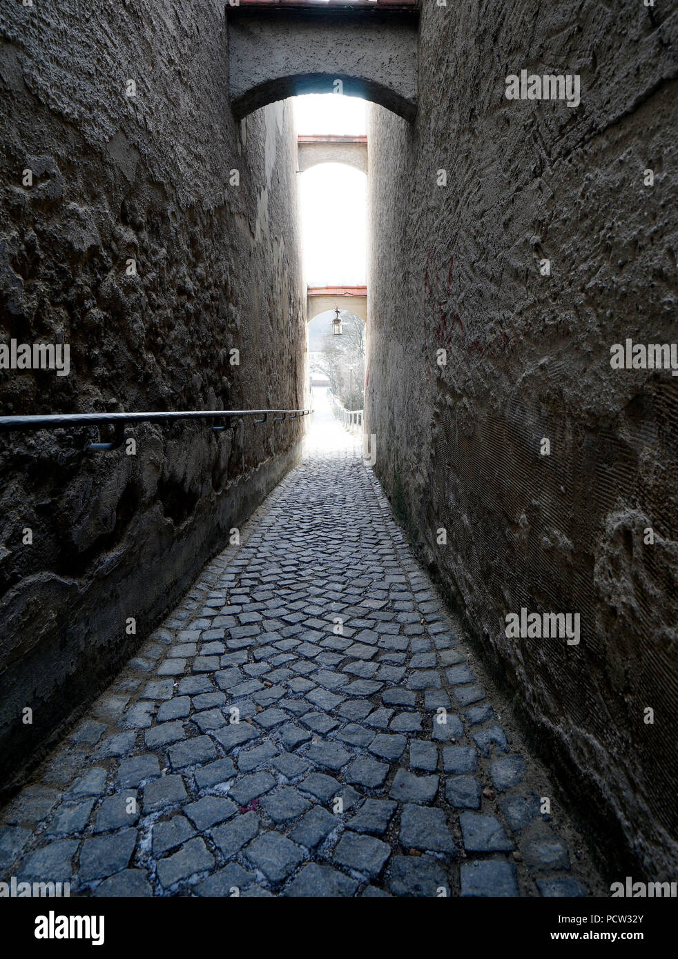 Germany, Bavaria, Upper Bavaria, Neuötting, narrow lane, paved, gloomy Stock Photo