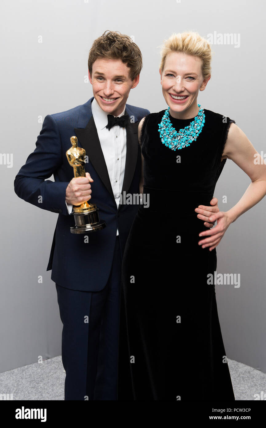 """HOLLYWOOD, CA - FEBRUARY 22: Eddie Redmayne poses backstage with the Oscar® for Performance by an actor in a Leading role, for work on """"The Theory of Everything"""" with presenter, Cate Blanchett during the live ABC Telecast of The 87th Oscars® at the Dolby® Theatre in Hollywood, CA on Sunday, February 22, 2015. - Stock Image"""