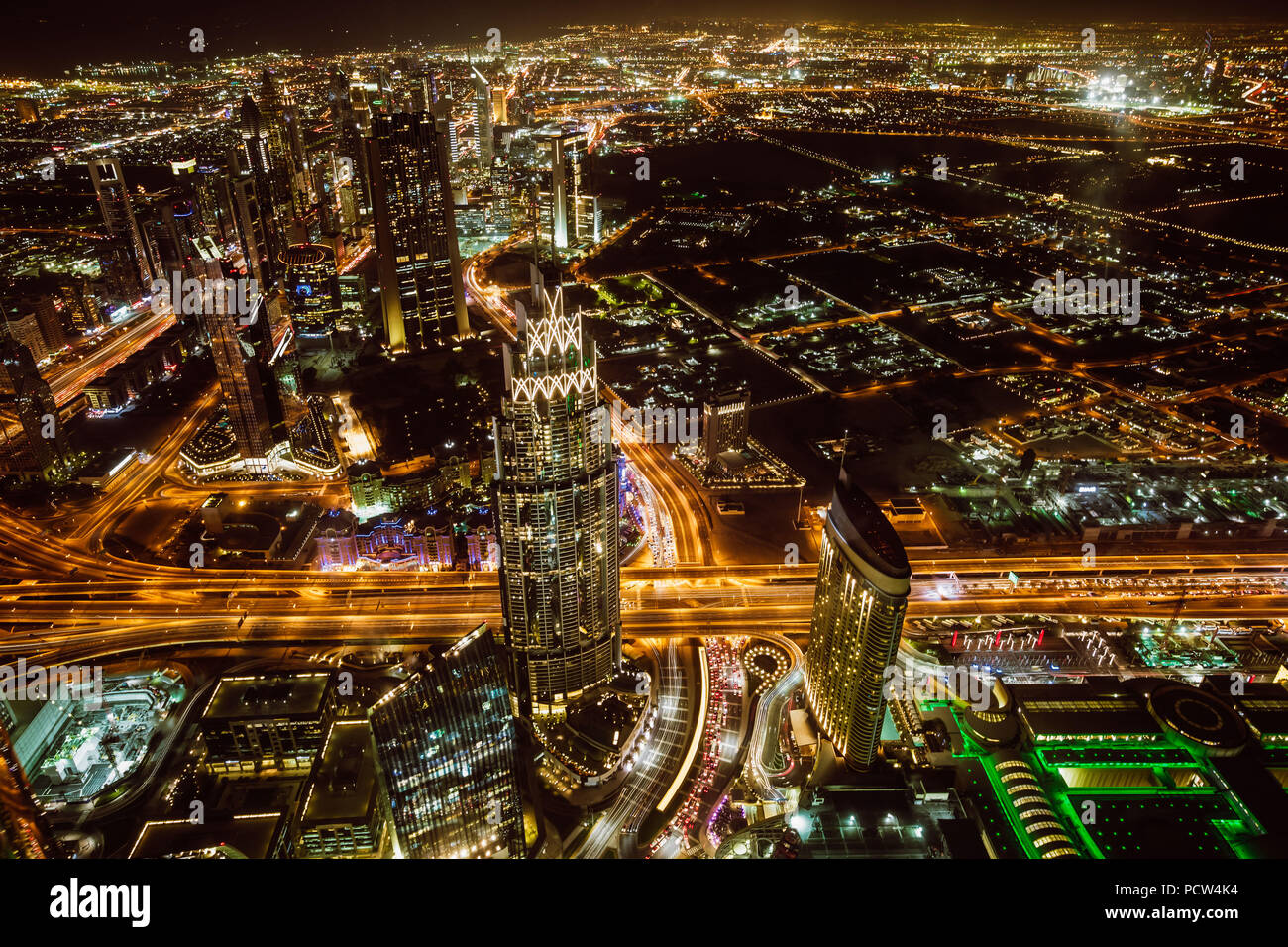 Aerial view of downtown Dubai and skyscrapers at night from the top of Burj Khalifa - Stock Image