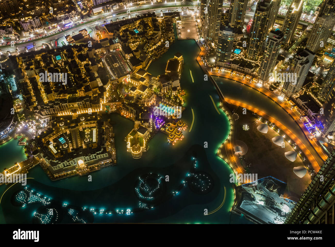 Detail aerial view at night of downtown Dubai and artificial lake, United Arab Emirates. - Stock Image
