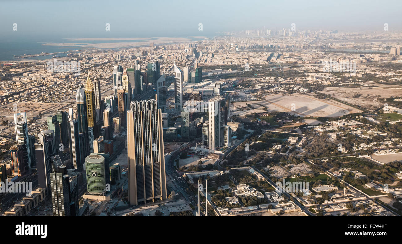 Dubai downtown afternoon scene. Top view from above with skyscrapers of Sheikh Zayed road. Panorama - Stock Image