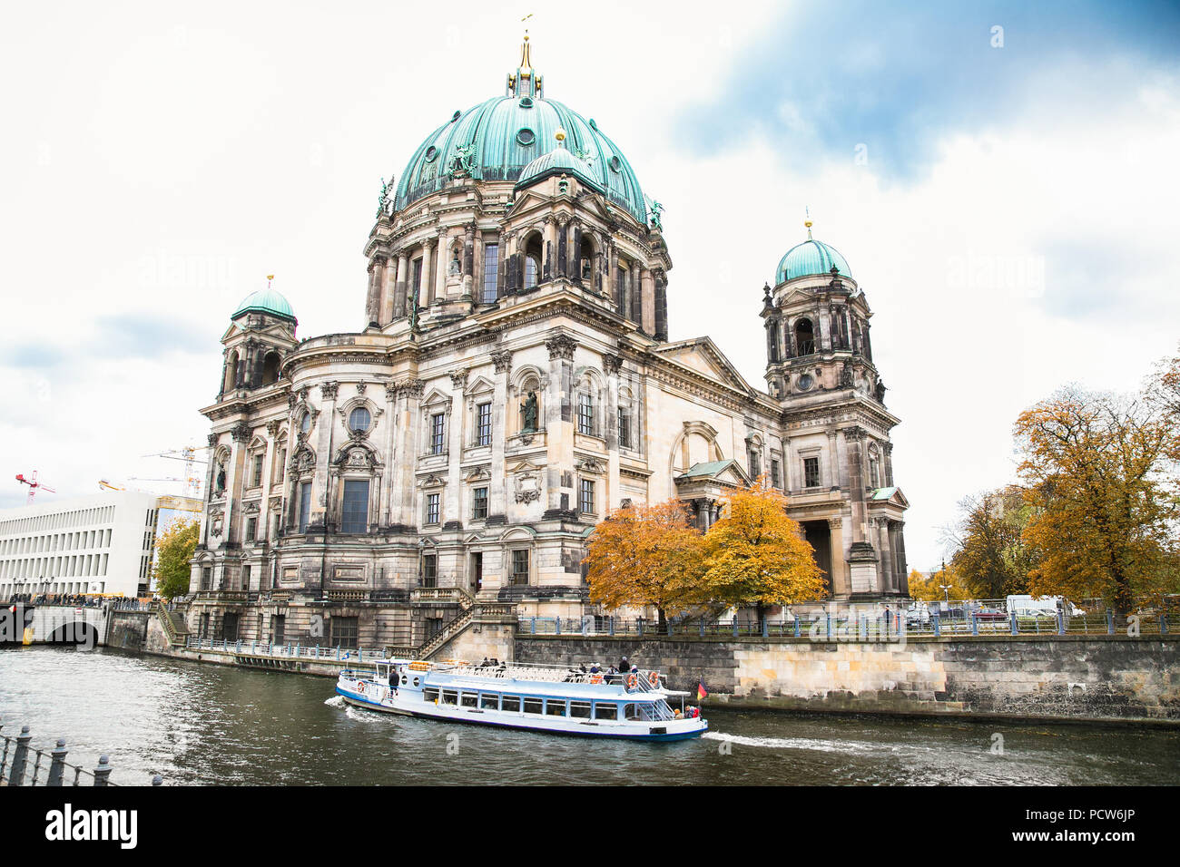 Beautiful view of Berliner Dom (Berlin Cathedral) at famous Museumsinsel (Museum Island) with excursion boat on Spree river in beautiful evening light - Stock Image