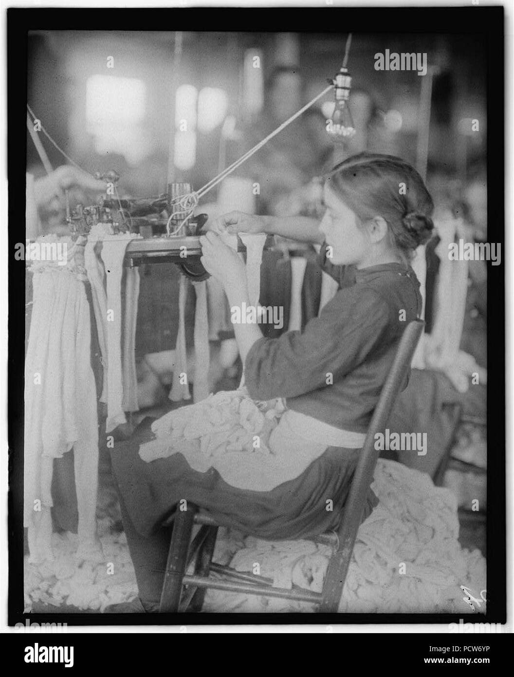 All these are workers in the Cherokee Hosiery Mill, Rome, Ga. Noon, April 10, 1913. The youngest are turners and loopers. Other Hosiery Mills around here employ children of 8 and 9 years. - Stock Image