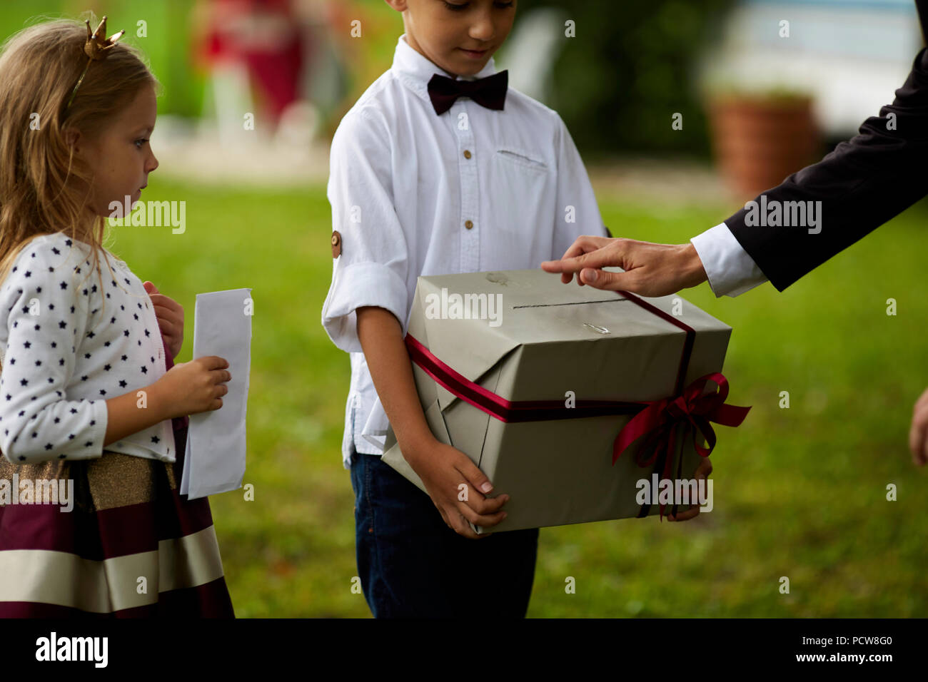 Father giving present to son. Happy smiling Boy receiving a gift. Happy family, Birthday, New year, Christmas concept - Stock Image
