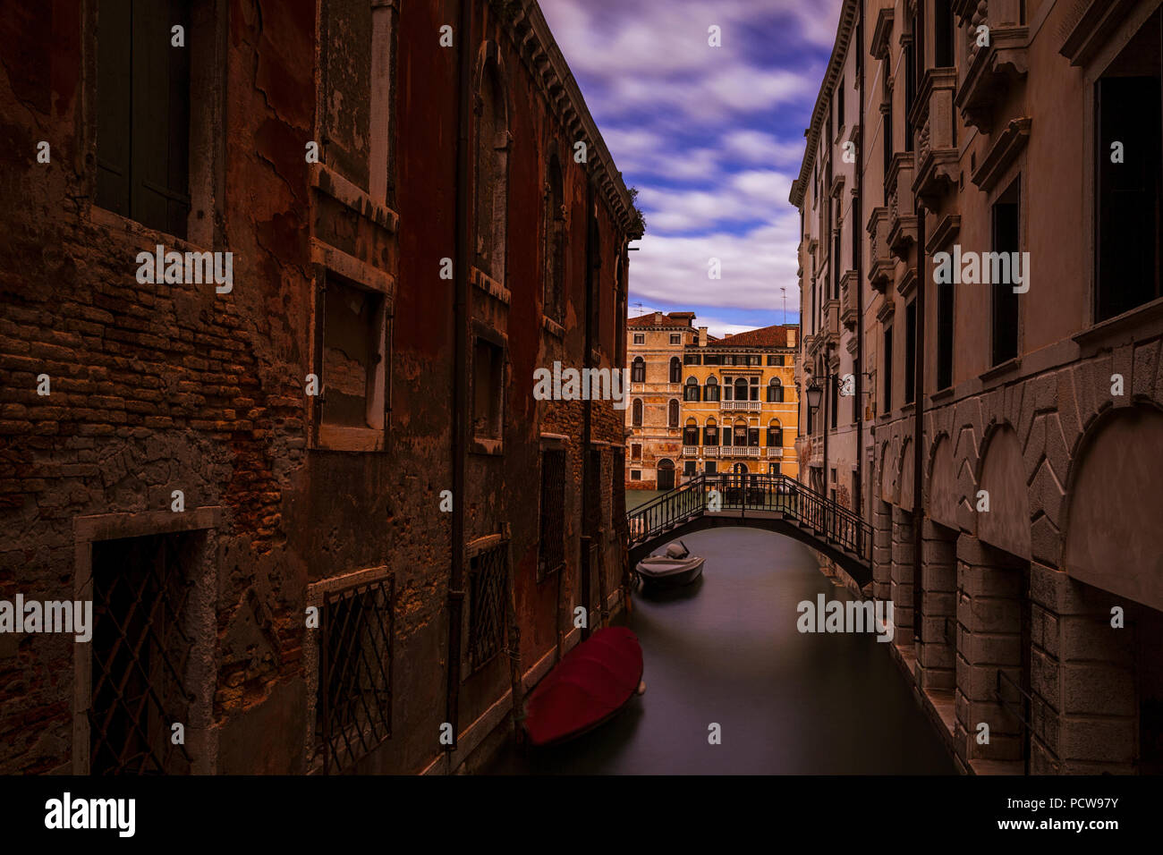 A narrow side canal in Venice, Italy - Stock Image