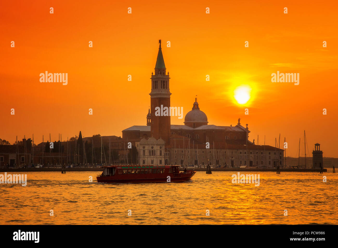 Venice's San Giorgio Maggiore island under a setting sun Stock Photo