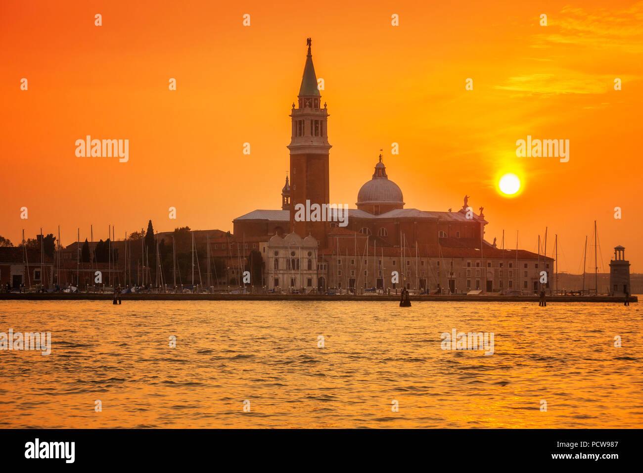 Venice's island of San Giorgio Maggiore under a setting sun - Stock Image