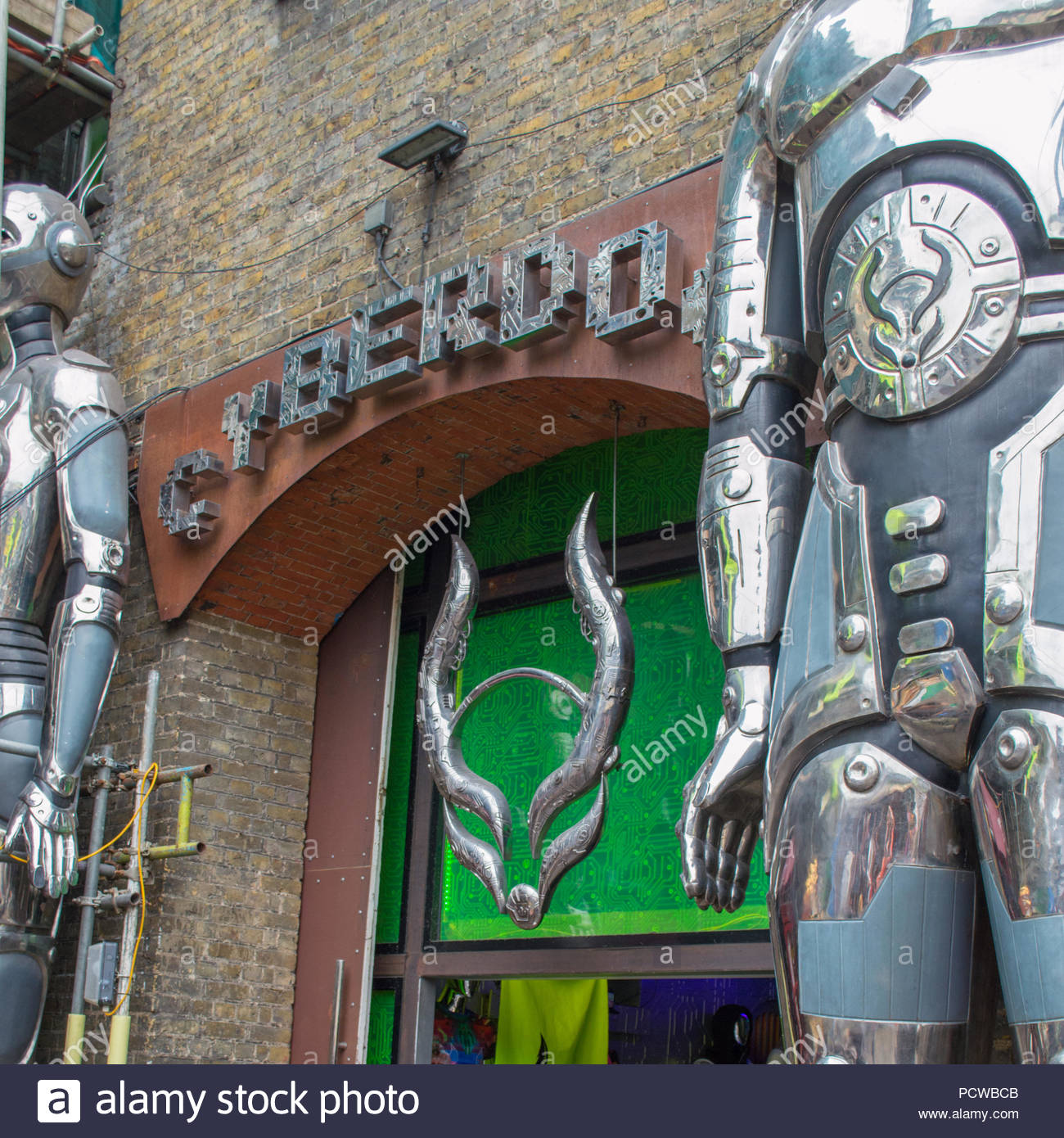 Logo and robot statues of Cyberdog on Camden Market in Londen United Kingdom - Stock Image