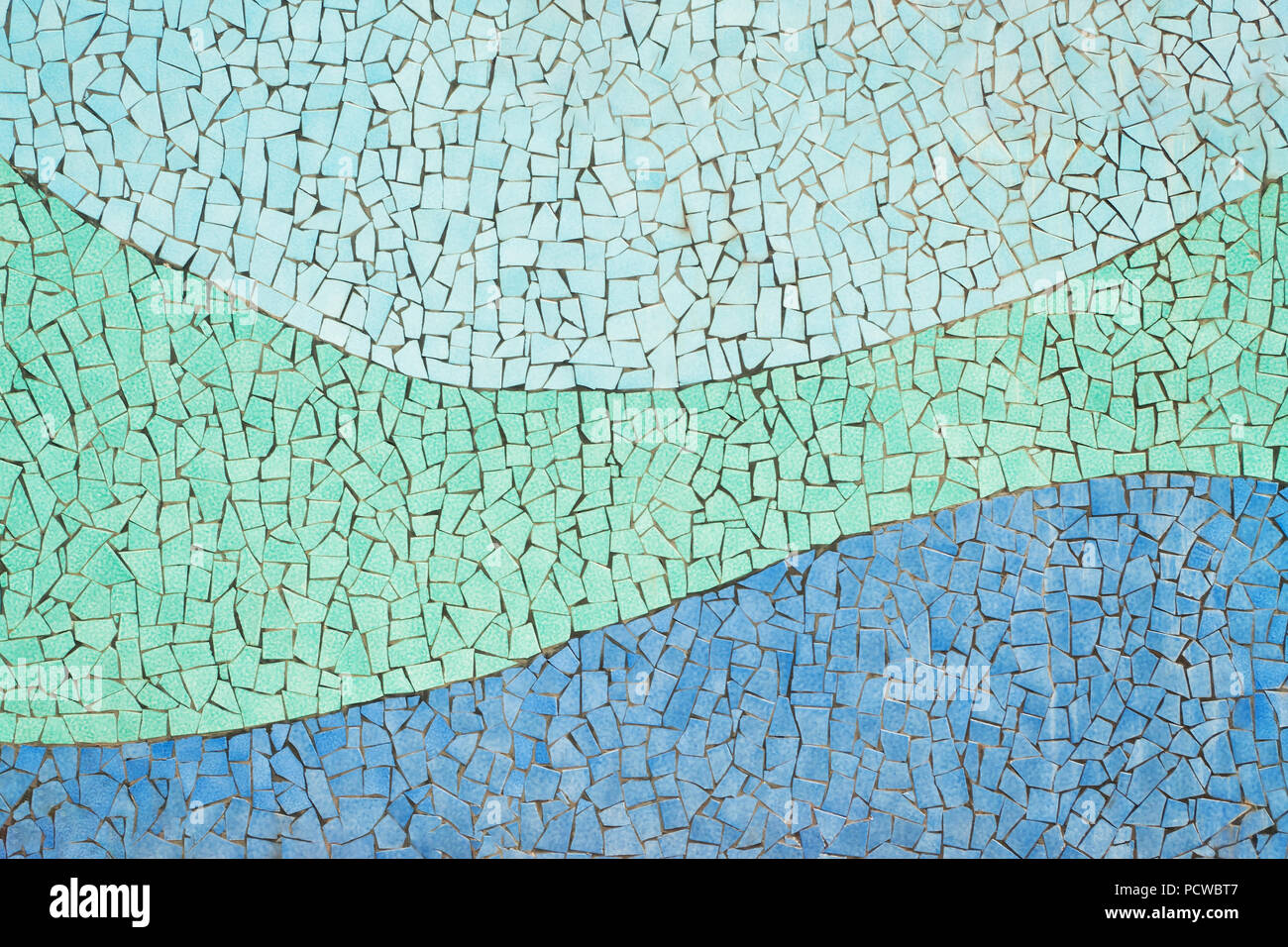 tiled ceramic mosaic wall with blue wavy lines in public park in city of ceramics, Vietri Sul Mare, Salerno, Campania, Italy Stock Photo