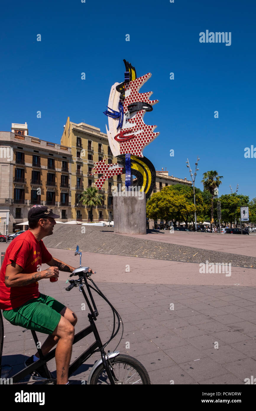 Cyclist passing in front of the El Cap de Barcelona, a surrealist sculpture created by American Pop artist Roy Lichtenstein for the 1992 Summer Olympi Stock Photo