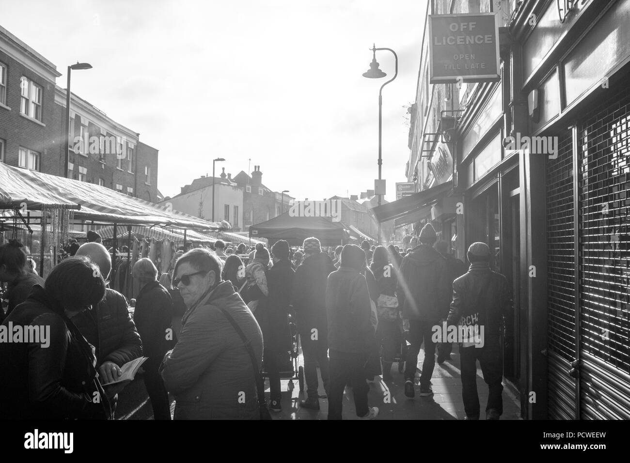 Popular Broadway Saturday market in the centre of Hackney, plenty of amazing food stalls, shops pubs and cafes. Black and white. London, England, UK. - Stock Image