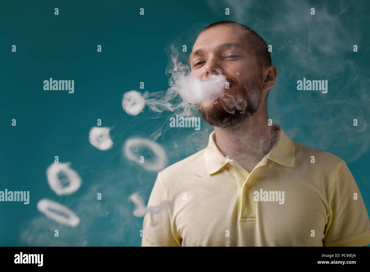 vaping man launches ring of the smoke - Stock Image