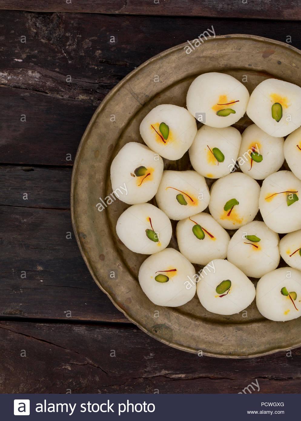indian sweet Rasgulla, Famous Bengali Sweet over white Background - Stock Image