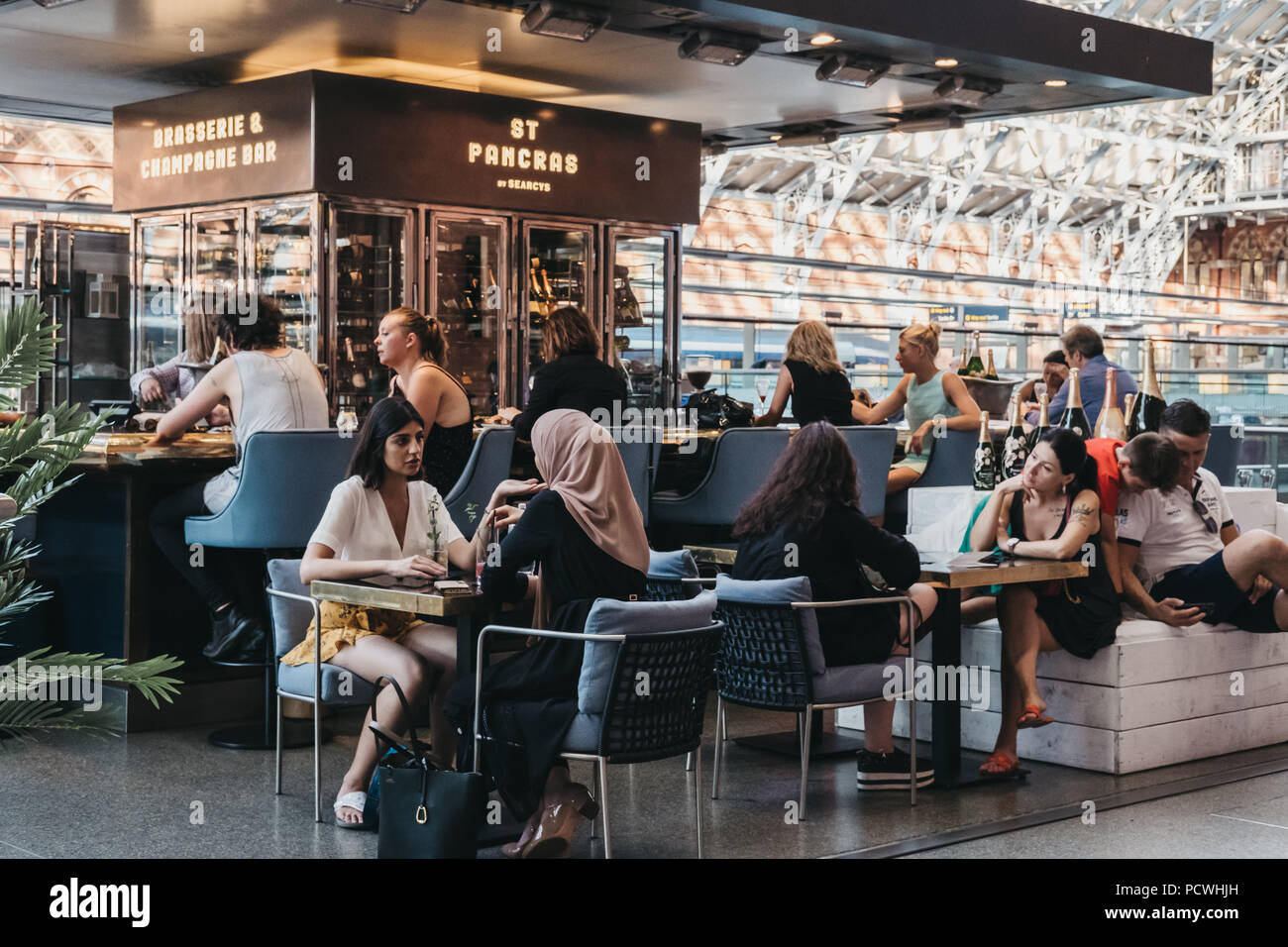 People Sitting At A Bar Inside St Pancras Station One Of The