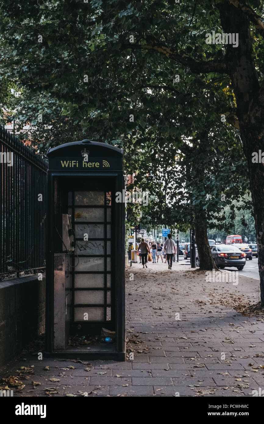 Black phone box on Euston Road in London, UK. - Stock Image