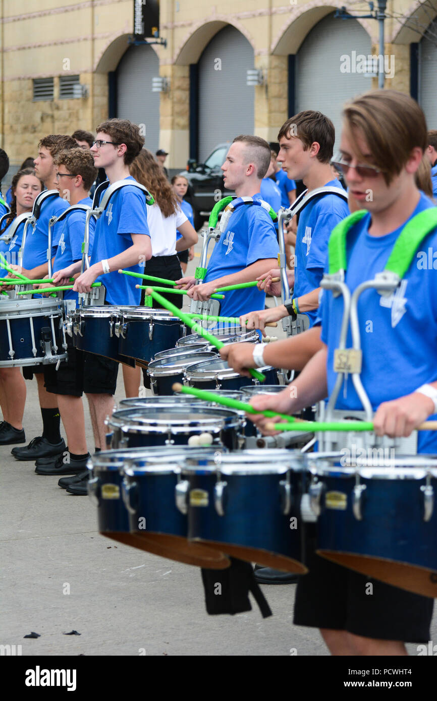 A line of drummers in a high school band. - Stock Image