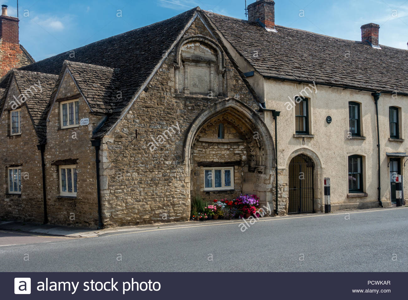 The exterior of the 13th century Hospital of St. John the Baptist, Malmesbury, Wiltshire. - Stock Image